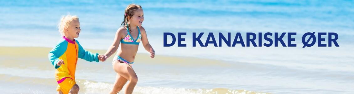 To børn som løber på en strand