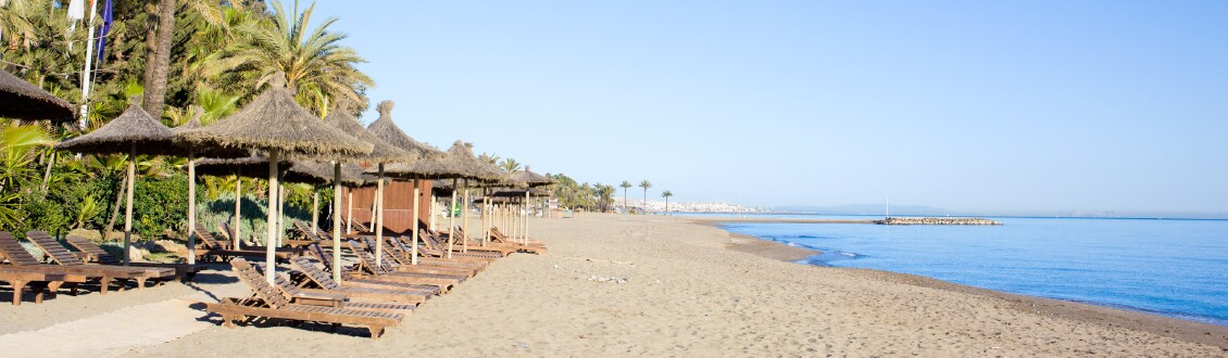 Sun loungers, beach and sea