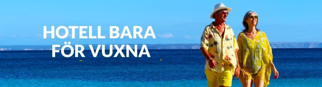 Ett man och en kvinna på stranden på Mallorca